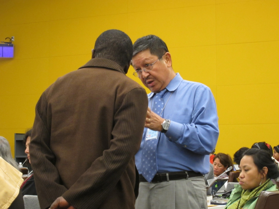 Navin Rai (right), the World Bank's top advisor on indigeneous peoples affairs from 2000 to 2012, talks with a member of the United Nations Permanent Forum on Indigenous Issues during a conference.